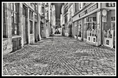 A Street in Ghent at night (NNJHA1971) Tags: street streetphotography windows shops night blackandwhite bw ghent stbaafscathedral riverleie