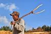 Farmworker in Ethiopia (Neal J.Wilson) Tags: ethiopia africa farming farmworkers fork reallife travel nikon man portraits african ethiopian hat cap tigray