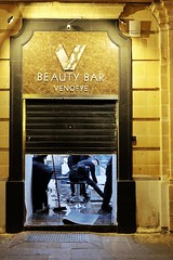The Final Cut (Douguerreotype) Tags: people city street night shop malta urban valletta door store