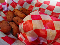 Supper At Tyson's Corner. (dccradio) Tags: lumberton nc northcarolina robesoncounty inside indoors restaurant food eat eatout friday fridaynight meal sandwich hamburger cheeseburger red white square checkered hamburgerbun hamburgerroll hushpuppies supper dinner lunch samsung galaxy smj727v j7v cellphone cellphonepicture