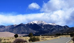 Road to the Dunes (Patricia Henschen) Tags: greatsanddunesnationalpark nationalpark greatsanddunes sand sanddunes sangredecristo mountains mountain clouds sanluisvalley road pathscaminhos nps nationalparkservice spring alamosa colorado mosca