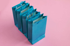Group of blue gift bags on pink background. (wuestenigel) Tags: bag color spree shopping box standing space background holiday container sale design isolated row white view retail present label bags gift vector empty red blue colorful ribbon beautiful object pink many packaging purchase package illustration paper girly buy papier noperson keineperson surprise überraschung geschenk christmas weihnachten business geschäft cardboard karton square platz desktop shape gestalten birthday geburtstag bow bogen abstract abstrakt show one ein thread faden