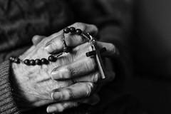 Una Piccola Preghiera (W@nderluster) Tags: prayer preghiera god christ desire blackandwhite bw monocrome canon people eos 50mm rosario hands deptoffield bokeh cross christian noiretblanc hand mani manos