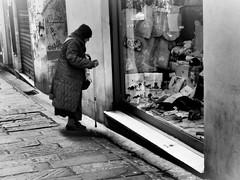 ️...  It seems the hardest world... 🎹 (VauGio) Tags: ancientwoman vecchina street olympus omd10 bianconero blackwhite eltonjohn sorrytobetheharvestworld