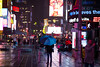 Daily life imagery shot in rainy conditions in Times Square around midnight between Sunday, April 15, 2018 and Monday, April 16, 2018. Benjamin Kanter/Mayoral Photo Office. (nycmayorsoffice) Tags: boroughs manhattan midtown newyorkcounty rainy shotforthemayorsoffice ts timesquare timessquare weather rain raining umbrella