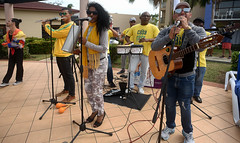 ...And the Band Played On (Poocher7) Tags: people portrait group band microhones singing singers percusion flute guitar bongos sunglasses yellow rhythm music cuban varadero cuba carribean