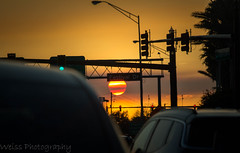 On the move @ Dusk (tshabazzphotography) Tags: sun sunset sunsetporn dusk traffic cars street driving streetlight streetsign trafficlight signs light sunny sky capture moment grind life daily ngc national geographic car road