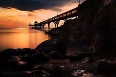 Silence is golden (Photography by Julia Martin) Tags: photographybyjuliamartin sunsetlight clevedon clevedonpier httpwwwclevedonpiercom rocks silhouette sunset silenceisgolden coastalscene victorianpier oldpier somerset uk