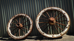 Wagon Wheels (Theen ...) Tags: corrugated iron kangarooisland penneshawmuseum roundabout rusty shed spokes wagon wheels wooden