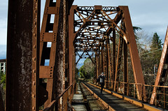 The guy with the camera takes pictures on the bridge (ivan_volchek) Tags: bridge wood outdoors expression travel visiting construction iron locomotive railway architecture wooden steel train rusty rust industry old guy camera