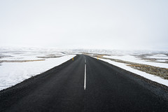 Bright and Dark, Black and White (JeffMoreau) Tags: thingvellir þingvellir iceland road street black white snow snowy zeiss 16mm mossy contrast a7ii