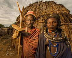 The Arbore Elders (Omo Valley, Ethiopia 2014) (Alex Stoen) Tags: 1dx africa african alexstoen alexstoenphotography arbore canon canoneos1dx couple creativelighting culture ef1635f28liiusm elders ethiopia flickr geotagged google natgeo nationalgeographicexpeditions omovalley parents pocketwizard portrait tradition travel tribes vacation facebook hut offshoeflash smugmug