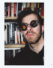 (|Digital|Denial|) Tags: instaxwide fujifilm instantphotography selfportrait bookshelf books skulls sunglasses punk