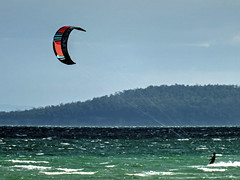 Kiteboardning.- (AdamsWife) Tags: australia tasmania sport kiteboarding water wind kite waves