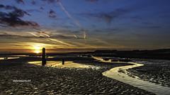 Llanelli sunset 2 (stevenbailey7) Tags: sunset sky clouds nature weather beach landscape seascape light water sea equinox spring colours colour seaside holiday orange sun blue