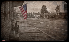 Flag of Our Fathers (MBates Foto) Tags: aged availablelight city color daylight existinglight flag nikkorlens nikon nikond810 nikonfx old outdoors rain sepia street textures urban medicallake washington unitedstates 99022