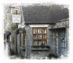 The Little Sweet Shop (Audrey A Jackson) Tags: canon60d bourtononthewater costwolds advertising smartphotoeditor door window flowers architecture