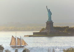 Ode to the Immigrants (Brian Knott Photography) Tags: urban city ny nyc newyork newyorkcity manhattan newjersey sky water ocean sea atlantic bay harbor atlanticocean hudson hudsonriver eastriver sunset sunrise eastcoast northeast statueofliberty statue icon usa america freedom ship boast buildings skyline tallship