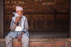 Old man smoking in Bhaktapur (puuuuuuuuce) Tags: portrait smoking cigarette nepal bhaktapur