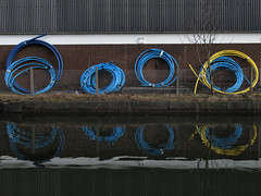 OoOO *explored* (Claire Wroe) Tags: manchester bridgewater canal reflect reflection pipe circle plastic blue yellow water building industry industrial park trafford way explore explored