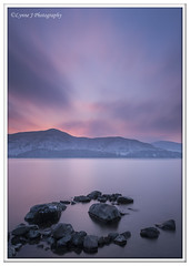 ABC_9906 - explored (Lynne J Photography) Tags: lakedistrict derwentwater bluehour longexposures jetty ashnessjetty water rocks lonetree gressmere mountains hills snowcappedpeaks sunset