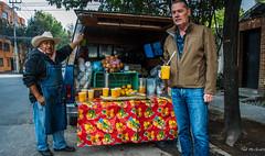 2018 - Mexico City - OJ, Man (Ted's photos - Returns Early June) Tags: 2018 cdmx cityofmexico cropped mexico mexicocity nikon nikond750 nikonfx tedmcgrath tedsphotos tedsphotosmexico vignetting oj orangejuice juice fruit drinks males men pose posing denim denimjeans apron hat cups moustache streetscene street truck vehicle jacket sweater zipper orange red redrule