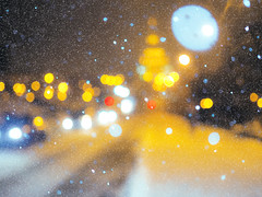 Blurred picture of park at the snowfall with lights (mironenko1990) Tags: winter background night park christmas blurred snowfall snow new year city beautiful holiday happy street light landscape view relationship evening blur cold season tree xmas young merry card bokeh clothing square backdrop snowy snowflake alley blurry people greeting walking warm