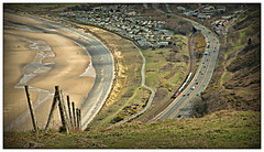 Skipping to the beach (david.hayes77) Tags: class67 skip 67015 penmaenbach conwybay conwy 1d34 wales northwales cymru atw arrivatrainswales dbcargo db fence beach sand coast a55 northwalesexpressway caravanpark mobilehomes lightandshade