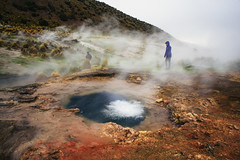 geysers without guardrails (almostsummersky) Tags: geothermalpool rock geyser hotspring altiplano scrub bolivia stream southamerica hill steam sabbatical steppe rain person people sajamanationalpark rockformation geothermal parquenacionalsajama nationalpark
