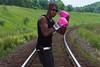 Harvard Jones on the Tracks. (PebblePicJay) Tags: boxing gloves pink railroad rail sunglasses flickr grass portrait canon canon6d 85mm trees toronto comedy