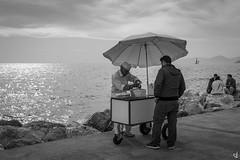 I scream! (tzevang.com) Tags: seascape seaside greece icecream bw bythesea salesman