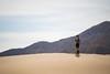 Ed in the Dunes (thedailyjaw) Tags: deathvalleynationalpark usnationalpark deathvalley desert landscape nikon d610 texture form lightandshadows travel camping badwaterbasin devilsgolfcourse mesquiteflatsanddunes sand arid dry heat bokeh desertbokeh