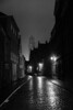 Oostmeers toward Sint-Salvator, Bruges, Belgium (Plan R) Tags: cobblestone night evening rain blackandwhite bruges cathedral dark leica m 240 noctilux 50mm