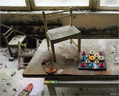 In a Pripyat Children's Nursery (Aad P.) Tags: chernobyl чорнобиль pripyat припять ukraine україна sovietunion cccp nuclearpowerplant radioactivity radiation urbex urbexphotography exclusionzone toy childrensnursery childrenschair toys