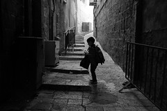 A child's journey to school (michael.mu) Tags: jerusalem muslimquarter theleicameet dailylife leica m240 35mm leicasummicron35mmf20asph streetphotography monochrome bw blackandwhite