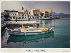 Agios Nikolaos, Crete (Helene Iracane) Tags: agios nikolaos saint nicolas greece grèce greek island crete crète kreta water eau boat bateau postcard bleu blue turquoise teal drapeau flag grec waterscape ciel sky mer sea seaside port