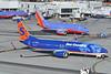 Hot Narrowbody Action (Rich Snyder--Jetarazzi Photography) Tags: suncountryairlines suncountry scx sy southwestairlines southwest swa wn boeing 737 737800 7378bk b737 b738 737700 7377h4 b73g n815sy n227wn departure departing sanfranciscointernationalairport sfo ksfo millbrae california ca airplane airliner aircraft jet plane jetliner ramptowera rcta atower