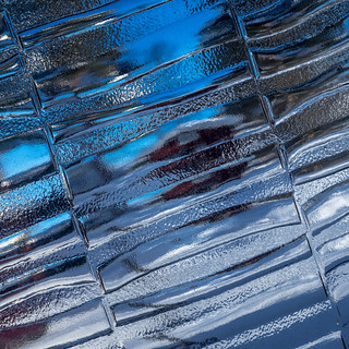 Glassy ice or icy glass?