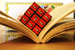The fun is in placing everything on its correct place💟 (sonaliramola) Tags: book rubik cube stilllife red novel brown doodle floor
