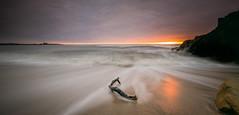 Newbiggin by the Sea (ianbrodie1) Tags: sunrise longexposure newbigginbythesea northumberland coast sand bay leefilters waves water sea seascape church cloud rocks driftwood