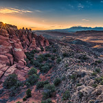 Sandstone Sunrise.  Morning breaks over the narrow canyons and towering red cliffs known as the Firey Furnace section of Arches National Park near Moab, Utah thumbnail