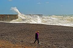 Take a walk on the wild side (Geoff Henson) Tags: storm sea ocean girl walk beach waves jetty pier tide 1000v40f