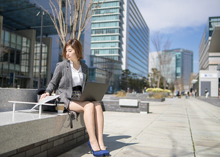 Young business woman working outside in city