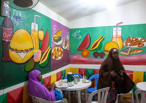Somali women inside a restaurant with decorated walls, Woqooyi Galbeed region, Hargeisa, Somaliland