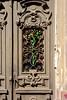 La Rose de Fer (Brînzei) Tags: cluj clujnapoca fujifilmxt1 fujinonxf35mmf14 iuliumaniu artifacts brown cavemanart decay doors flowers green junkyard ornaments roses rusty