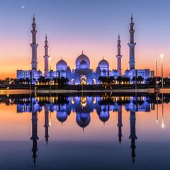 Spiritual Sunset (Wissam Chehade) Tags: uae abu dhabi cityscape gold reflection islam religion domes mosque szgm sheikhzayedgrandmosque citylights cityview