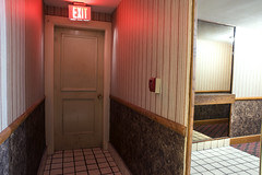 (Curtis Gregory Perry) Tags: seattle washington exit sign door night long exposure hallway hotel lodging red light nikon d810 fire alarm emergency wallpaper tile floor wall carpet wood mirror reflection