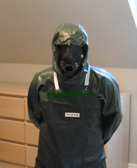 7 (gummifan61) Tags: rainwear raingear rubberslave rubber gasmaske bondage apons gags
