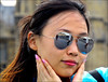 `2223 (roll the dice) Tags: london streetphotography pretty sexy girl hit sunny weather uk art classic urban england unknown unaware people fashion tourism tourists portrait strangers candid westend shops shopping natural mad sad fun funny bored chinese glass reflection sunglasses canon face pink colour korean bigben pose fingers mouth cute asian