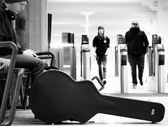 Have Guitar, Will Travel (dave777_uk) Tags: guitar musician guitarcase nottingham street blackandwhite bw monochrome station railwaystation olympus epl7 m43 railway